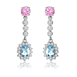 A beautiful designer dangling. 1.5 ct. oval Blue Topaz essence surrounded by round brilliant melee,  and 1 ct. round Pink Essence are connected by bezel set round stones. 6 cts.t.w. in Platinum Plated Sterling Silver.