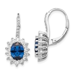 An alluring pair of prong set earrings for women with simulated oval cut sapphire in center surrounded by round brilliant melee Diamonds in floral pattern by Diamond Essence set in platinum plated sterling silver. 5.0 Cts.t.w.
