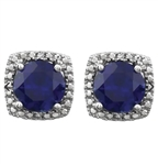 Designer Stud Earrings. One carat Sapphire Essence Round cut stone in four prongs setting and with Diamond Essence melee. 2.5 cts.t.w. in Platinum Plated Sterling Silver.