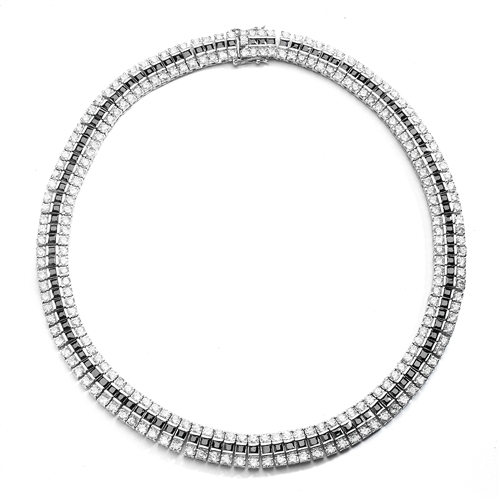 Brilliant craftmanship.This necklace is combination of prong set Round Diamond Essence and channel set Princess cut Onyx Essence stones.  Appx. 81.0 Cts.T.W. in Platinum Plated Sterling Silver.
