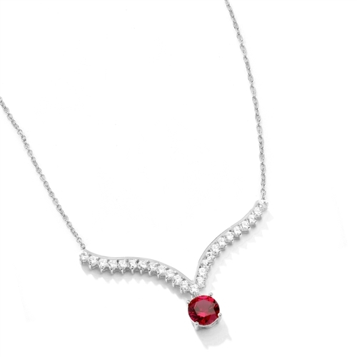 Supreme Necklace that is sure shot eye candy! 2.0 Cts. Round cut Ruby Essence Dangler atones a curvy melee of Round Brilliants set exquisitely in an Art Deco Setting! 3.50 Cts.T.W. attached with Chain in Platinum Plated Sterling Silver.