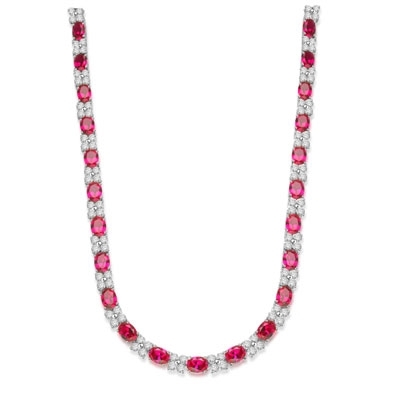 Diamond Essence Designer Necklace with 1.25 cts. Oval Ruby Essence and Round Diamond Essence Stones. Appx. 72.00 Cts. T.W. set in Platinum Plated Sterling Silver.