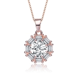 Designer pendant with 1.0 carat Round Brilliant Diamond Essence in the center, surrounded by baguettes in delicate prong setting of Rose Plated Sterling Silver. 2.0 cts.t.w.