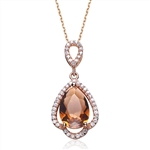 Diamond Essence Smoky Quartz 5 carat stone set in prong settings. Artistically surrounded by Diamond essence melee set in Rose plated Sterling Silver. 5.25 cts.t.w. Chain not included.