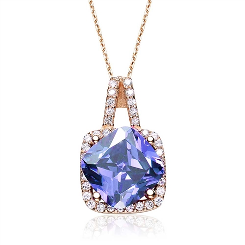 Diamond Essence Pendant with 5 Cts. Cushion cut Tanzanite in Four Prongs surrounded by Brilliant Melee in Platinum Plated Over Sterling Silver.