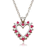 Ruby Essence Heart Pendant - 0.5 Cts. T.W. set in Platinum Plated Sterling Silver.