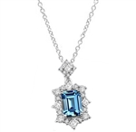 Diamond Essence emerald cut aquamarine stone, surrounded by melee and square cut aquamarine stones, 4.50 cts.t.w. set in Platinum Plated  Sterling Silver. (Chain not included).
