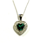 Heart shape Emerald Essence stone in prong setting, is surrounded by round brilliant Diamond Essence stones, making another heart. 2.5 cts.t.w. in Platinum Plated Sterling Silver.