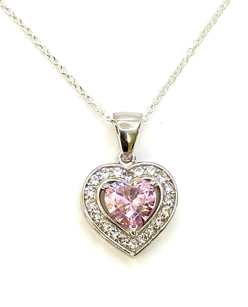 Heart shape Pink Essence stone in prong setting, is surrounded by round brilliant Diamond Essence stones, making another heart. 2.5 cts.t.w. in Platinum Plated Sterling Silver.