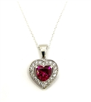 Heart shape Ruby Essence stone in prong setting, is surrounded by round brilliant Diamond Essence stones, making another heart. 2.5 cts.t.w. in Platinum Plated Sterling Silver.