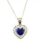 Heart shape Sapphire Essence stone in prong setting, is surrounded by round brilliant Diamond Essence stones, making another heart. 2.5 cts.t.w. in Platinum Plated Sterling Silver.