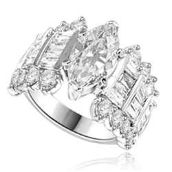 Diamond Essence Designer Ring, 3.0 Cts. Marquise cut Diamond Essence in center accompanied by baguettes and round Diamond Essence on side. 4.5 Cts. T.W. in Platinum Plated Sterling Silver.