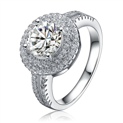 Diamond Essence Designer Ring with 2.25 carat Round Essence in center, surrounded by Round Essence melee in two rows around and two delicate rows on the band for more elegance. Appx. 3.50 Cts. T.W. set in Platinum Plated Sterling Silver.