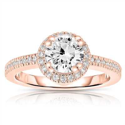 Diamond essence Designer Ring, with 1 carat Round Brilliant center stone set in artistic basket setting, surrounded by melee. Band with melee enhances the beauty, in Rose Gold Plated Sterling Silver.