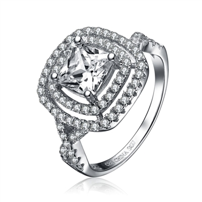 Diamond Essence Designer ring with 1.5 carat Princess cut center stone in prong setting, stands out with two outlines of diamond essence melee and intertwined design on band. 3.25 cts.t.w. in Platinum Plated sterling Silver.