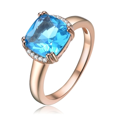 Diamond Essence Designer Ring with 2.5 carat Aquamarine Cushion Essence in 8 prongs setting and delicate melee set on two sides of cushion essence for additional beauty.2.60 Cts.T.W. in Rose Plated Sterling Silver.