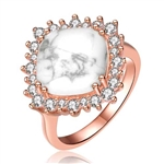 Diamond Essence Ring With How Lite Center Surrounded By Melee Set In 8 Prongs In Rose Plated Sterling Silver.