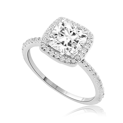 Beautiful Cushion Centerpiece, 1.5 cts, is surrounded by Round Brilliant Melee in this elegant engagement ring. The band consists of round pointer melee to form a brilliant radiance. Appx. 2.5 Ct. T.W. In Platinum Plated Sterling Silver.
