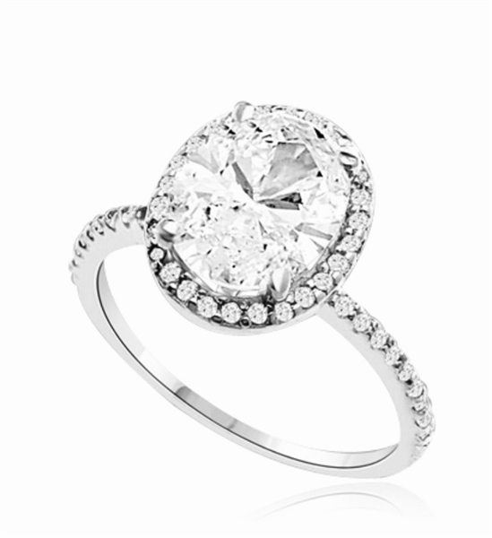 Beautiful Oval Centerpiece, 2.5 cts, is surrounded by Round Brilliant Melee in this elegant engagement ring. The band consists of round pointer melee to form a brilliant radiance. Appx. 3.5 Ct. T.W. In Platinum Plated Sterling Silver.