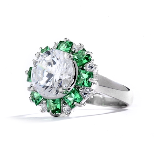 Classic Designer Ring with 3.0 Cts. Round Brilliant Diamond Essence Stone in the center, surrounded by 0.5 Ct. each, Green Princess cut stones and round stones.Round melee set on band, makes it more artistic. 9.50 Cts.T. W.