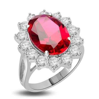Princess Ring with 6.0 Cts. Oval cut Ruby Essence center surrounded by 14 Round Brilliant Diamond Essence stones 6.50 Cts. T.W. set in Platinum Plated Sterling Silver.