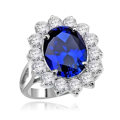 Platinum Plated Sterling Silver Princess ring with 5.0 cts. oval Sapphire Essence center and 14 round brilliant Diamond Essence stones 5.5 cts. T.W.