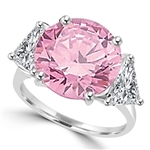 Risque- Diamond Essence Ring with 2 Carat Round Cut Pink Essence in Center and 0.5 Ct. Each trilliant cut side accents. 3.0 Cts.T.W. set in Platinum Plated Sterling Silver.