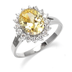 Light your Fire with this Cocktail Ring, 3.5 Cts T. W. with a 3 Cts. Oval Cut Diamond Essence Center and accents encircling the fireworks! In Platinum Plated Sterling Silver.