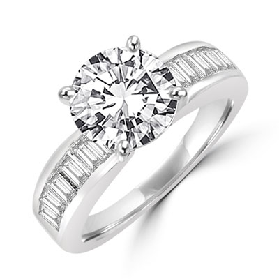 Diamond Essence Ring with 2.0 ct. Round Diamond Essence center with channel set baguettes on each side,2.5 ct. tw.in Platinum Plated Sterling Silver.