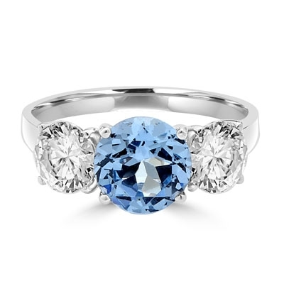 Three stone ring. Diamond Essence 2.0 carat Round Aquamarine stone in the center and 1.0 carat Round Brilliant stones on each side. 4.0 cts.t.w. Platinum Plated Sterling Silver.