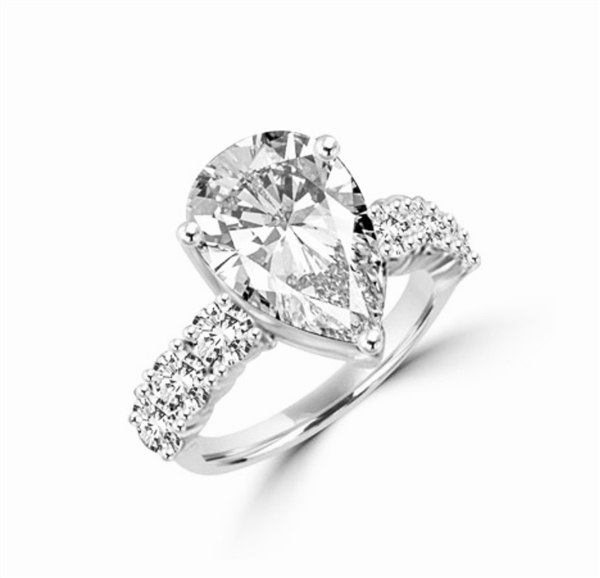 Majestic looking 6 carat Pear cut Diamond Essence stone and Round Brilliant stones on the band, 7.25 cts.t.w in Platinum Plated Over Sterling Silver.
