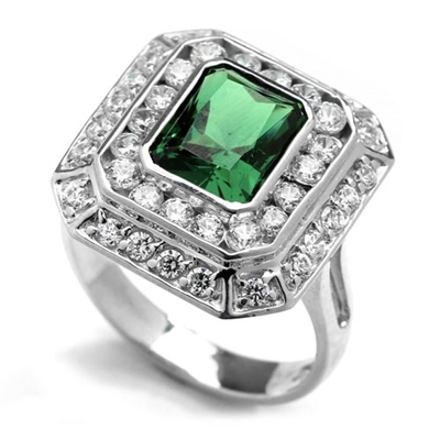 Diamond Essence Cocktail Ring With 2.50 Cts. Emerald Essence Radiant Emerald In Center Round Melee Around It, 4.50 Cts.T.W. In Platinum Plated Sterling Silver.