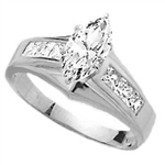 Diamond Essence Ring With 0.75 Ct. Marquise Center Followed By Channel Set Princess Stone Enhance the look Of Band In Platinum Plated Sterling SIlver, 1.50 Cts.T.W.