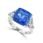 Sapphira - Fantastic Ring with a plush 4 Ct. Cushion Cut Sapphire Essence Masterpiece that highlights by each side of Trilliant accents.6 Cts. t.w. in Platinum Plated Sterling Silver , to chase your blues away!