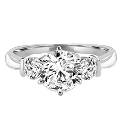 Platinum plated on sterling silver ring features a 2.0 ct. round cut Diamond Essence centerpiece rubbing elbows with two 0.3 round cut masterpices beside it. 2.6 cts. t.w. Breeding shows.