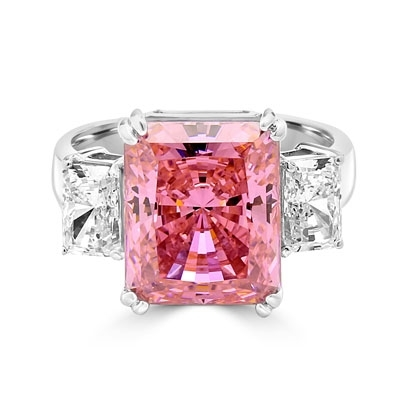 Pink Essence Ring—Emerald-cut 8-carat Pink Essence ring with Diamond Essence baguettes. 8.5 cts. T.W. set in Platinum Plated Sterling Silver.