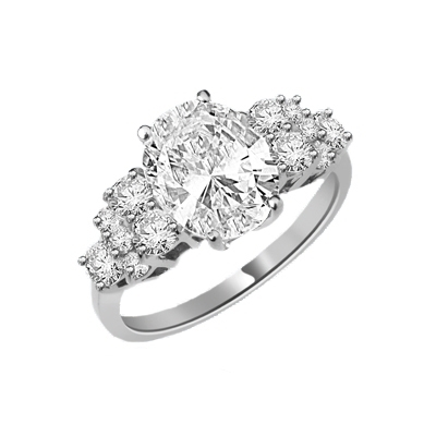 Designer Ring featuring a carefree display of 3.0 Cts. Oval Cut Diamond Essence Center Stone with the irresistible touch off six Round Brilliant Cut Masterpieces flashing temptingly on each side. 4.50 Cts.t.w.in Platinum Plated Sterling Silver.