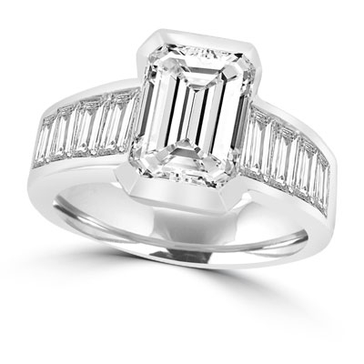 Escape with this Wide Band Ring with Channel Set Emerald Essence, 2.5 cts., separated by straight Diamond Bright Baguettes set vertically for a totally magnificent effect. 3.5 cts. T.W. set in Platinum Plated Sterling Silver.