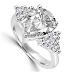 Blinding Beauty - She'll adore this outsized 2 Ct. Pear Shaped white Brilliant Diamond Essence masterpiece set with 3 dazzling round stones on either side of the band. Outstanding value for 2.30 Cts. T.W. in Platinum Plated Sterling Silver.