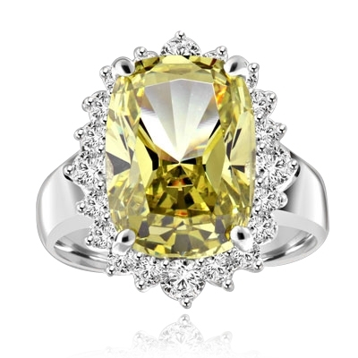 Ring with a oval cut 8.0 cts. Diamond Essence Peridot at the center, surrounded by round Diamond Essence stones, 9.0 cts.T.W. set in Platinum Plated Sterling Silver.