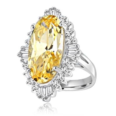 Designer ring with Diamond essence 9.0 cts. Canary stone in the center and encircled by round stones and a large spray of baguettes on all four sides. Wear it with confidence.10.75 cts. T.W. set in 14K Solid White Gold.