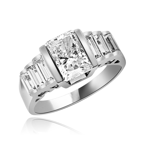 Great looking band with graduating baguettes on the band and 1.5 ct. radiant emerald Diamond Essence center, set in thick bar setting. 2.5 cts.t.w. in Platinum Plated Sterling Silver.