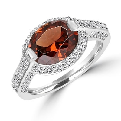 Diamond Essence designer ring with 2.5cts. Oval Chocolate Essence center surrounded by Round stones, 3.0ct. tw. in Platinum Plated Sterling Silver.