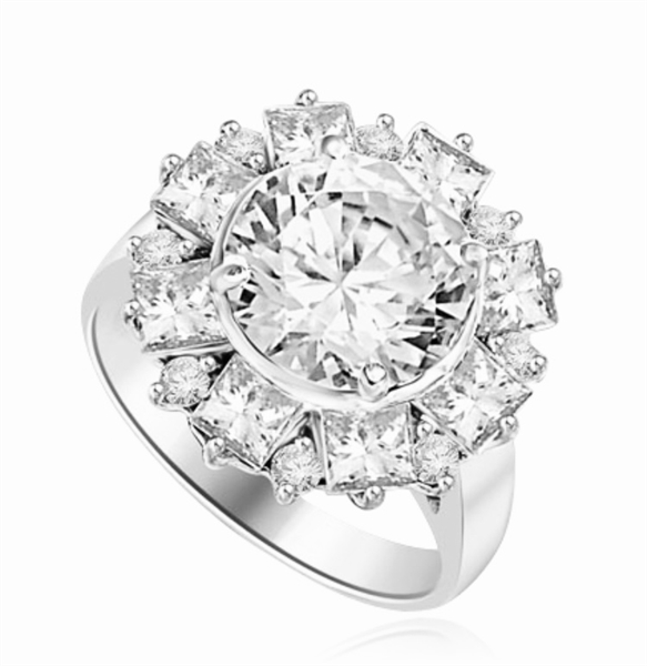 Diamond Essence Designer Ring With Round Brilliant Diamond Essence in center surrounded by alternately set Princess and melee. 7.25 Cts. T.W. set in Platinum Plated Sterling Silver.