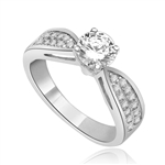 Sexy and Stylish 0.75 Ct. Round Stone Ring with deep channel set round accents on the band. 1.25 Cts. T.W. In Platinum Plated Silver.