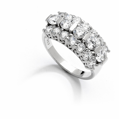 Wide Band Round Sparkles on Display - 2.5 Cts. T.W. In Platinum Plated Sterling Silver.