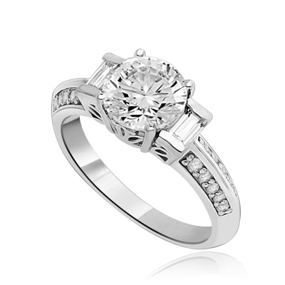 You will surly be pleased with this stunning new design. 2 Ct. Round Brilliant Diamond Essence Masterpiece is accentuated by channel baguettes and round melee on band. Ethnic carving on band makes this a uniquely adorable piece to collect. 2.75 Cts. T.W.