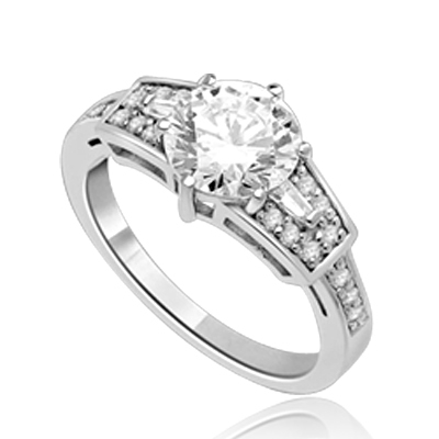 Mesmerizing 2.0 Ct Brilliant stone is adorned by superbly crafted Baguettes and Round Melee forming 2.5 Cts. T.W. In Platinum Plated Sterling Silver.