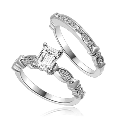 Beautiful Wedding Set with 1.0 Ct. Emerald cut Emerald Essence set in center accompanied by Melee on either side and on the matching band. 1.50 Cts. T.W. set in Platinum Plated Sterling Silver.