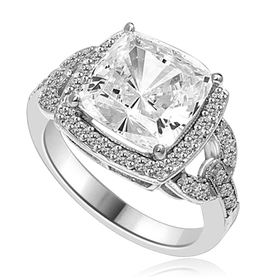 Diamond Essence designer ring 4.0 cts. Cushion cut Diamond essence set high in the center with melee around and on the band. 4.5 cts.t.w in Platinum Plated Sterling Silver.